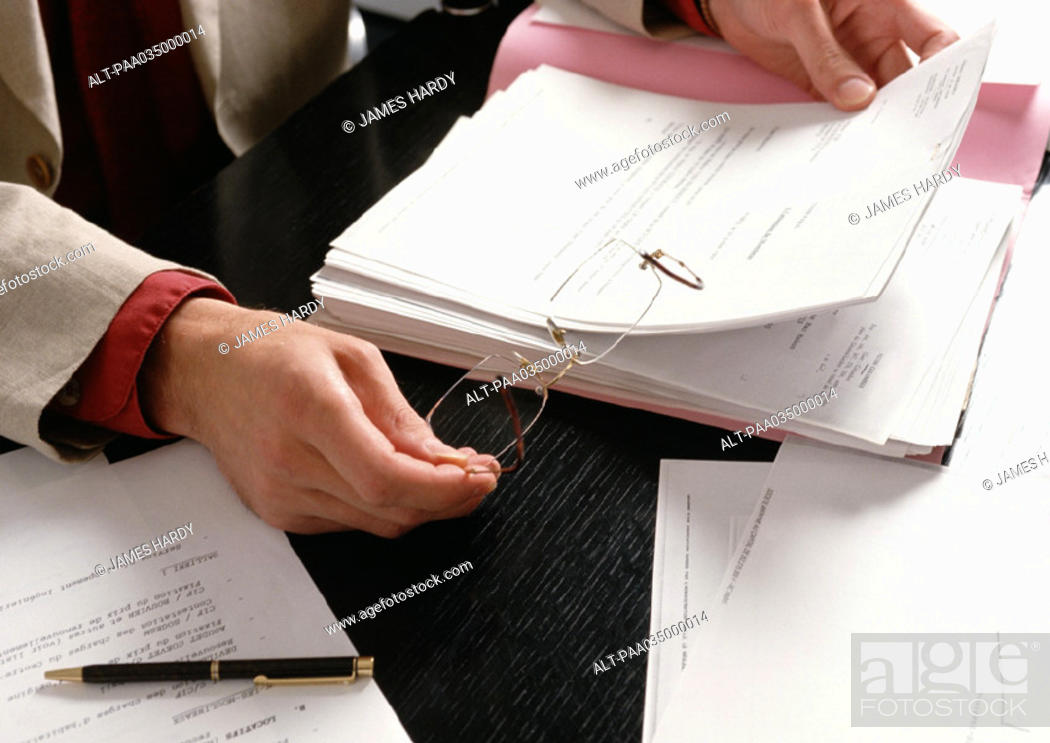 Stock Photo: Hands holding glasses and document.