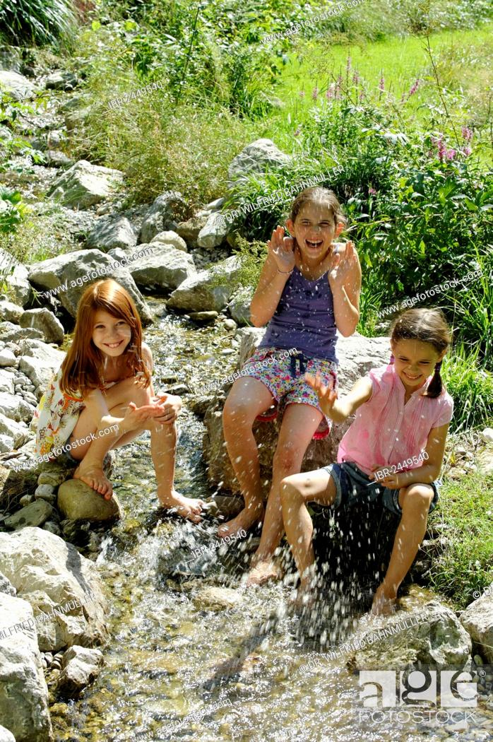 Stock Photo: Girls playing and splashing with water, water fight, Kräuter-Erlebnis-Park herb theme park, Bad Heilbrunn, Loisachtal, Tölzer Land, Upper Bavaria, Germany.