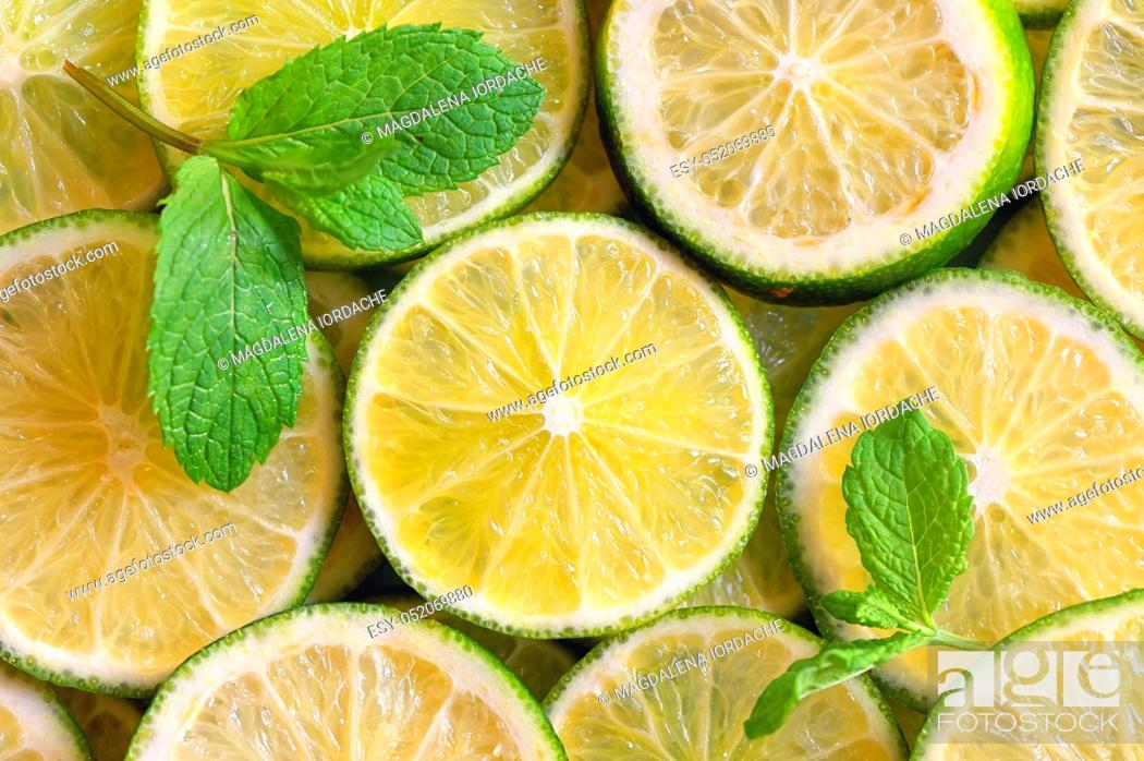 Stock Photo: Fresh Lemon slices background and mint leaves.