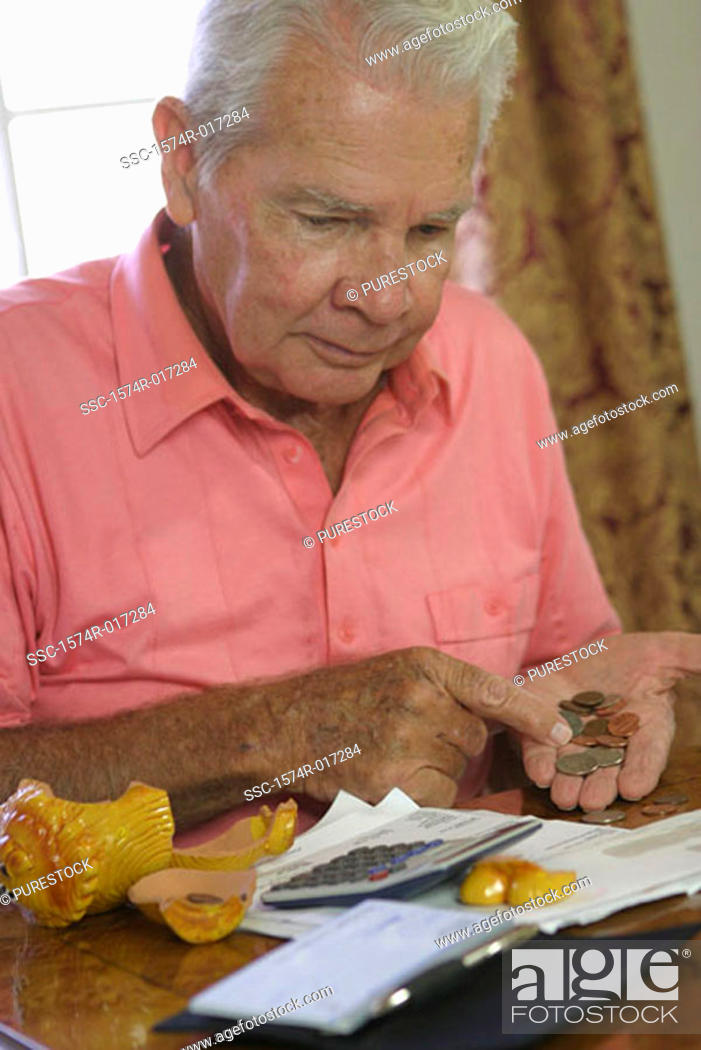 Stock Photo: Close-up of a senior man counting coins.