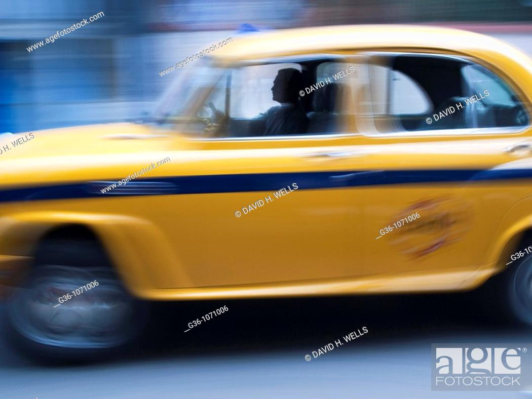 Stock Photo: Driver in a taxicab in Calcutta, West Bengal, India.