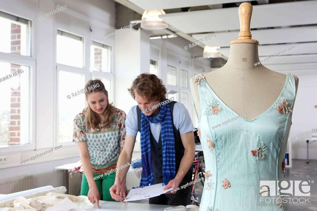 Stock Photo: Germany, Bavaria, Munich, Fashion designers planning.