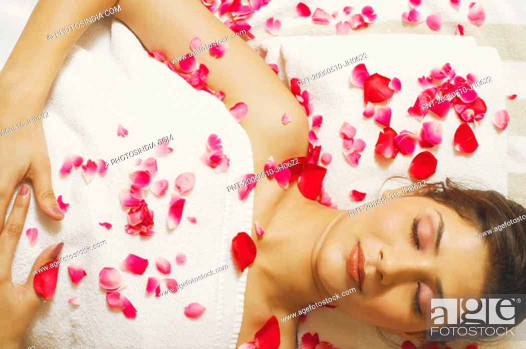Stock Photo: High angle view of a young woman lying on a massage table.