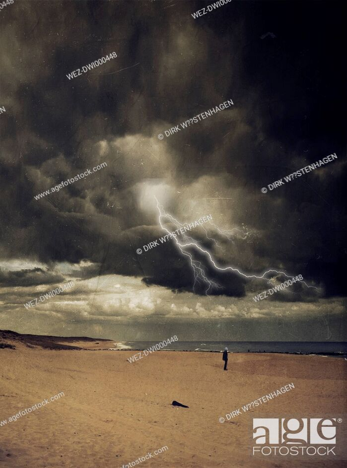 Stock Photo: France, Contis-Plage, man standing at beach, thunderstorm and lightning, digitally manipulated.
