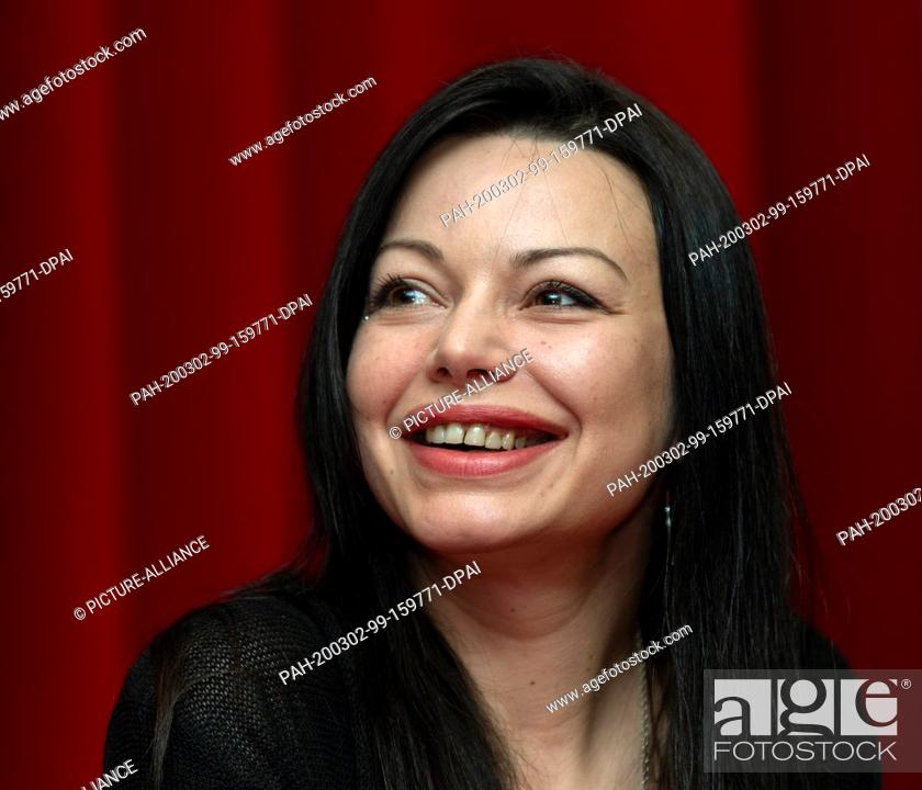 """Stock Photo: 02 March 2020, Saxony, Dresden: Actress Cosma Shiva Hagen sits on the podium at a press event of Comödie Dresden for the German premiere of """"""""Sternstunden""""""""."""