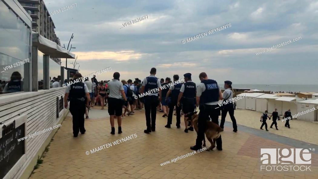 Imagen: ATTENTION EDITORS - VIDEO STILLS - BEST QUALITY AVAILABLE ..Police pictured after a massive brawl involving dozens of people broke out at the beach of.