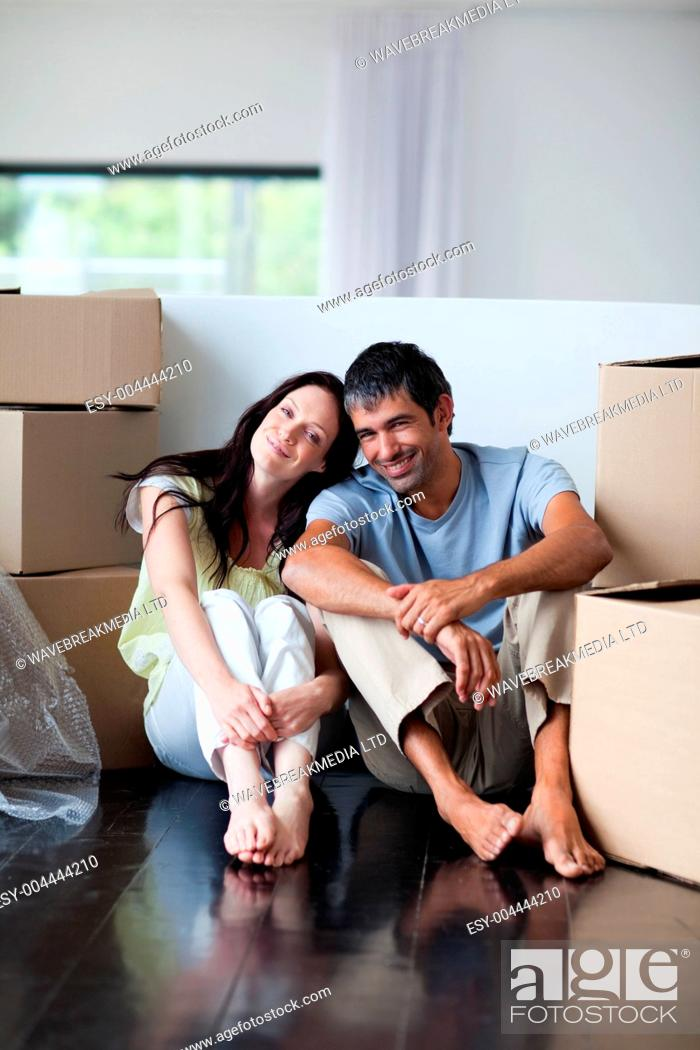 Stock Photo: Happy lovers moving house.