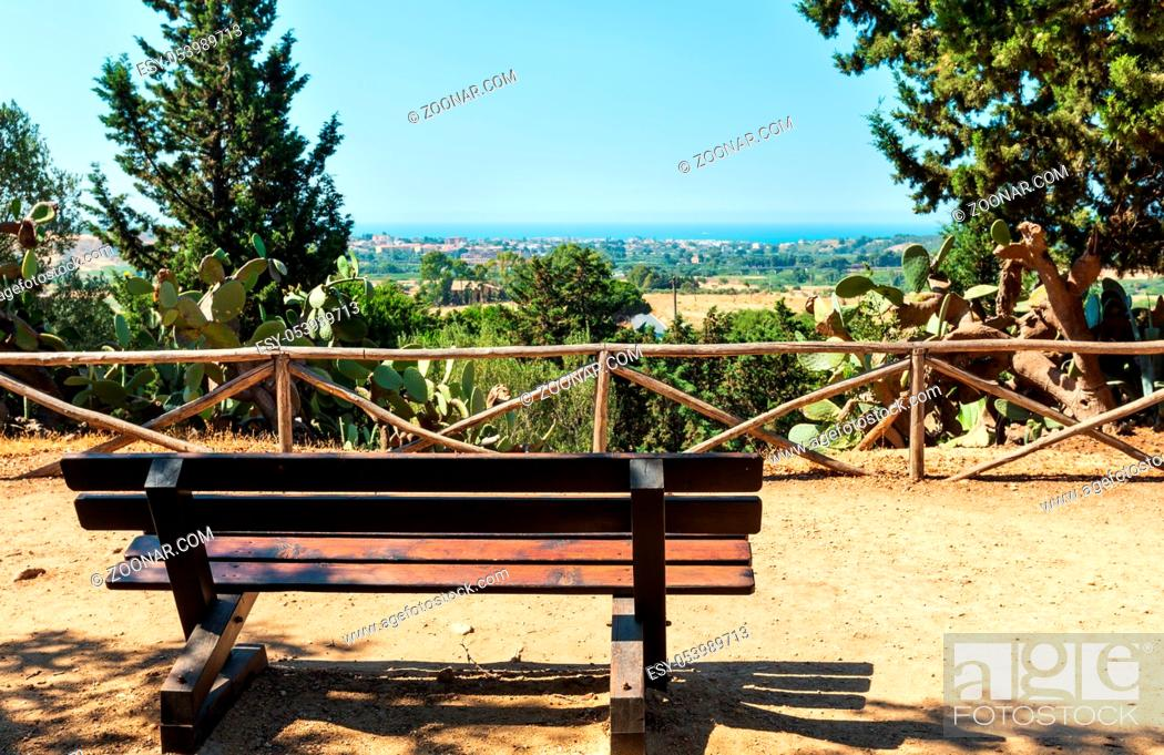 Stock Photo: Sea view from cypress avenue in famous ancient ruins in Valley of Temples, Agrigento, Sicily, Italy. UNESCO World Heritage Site.