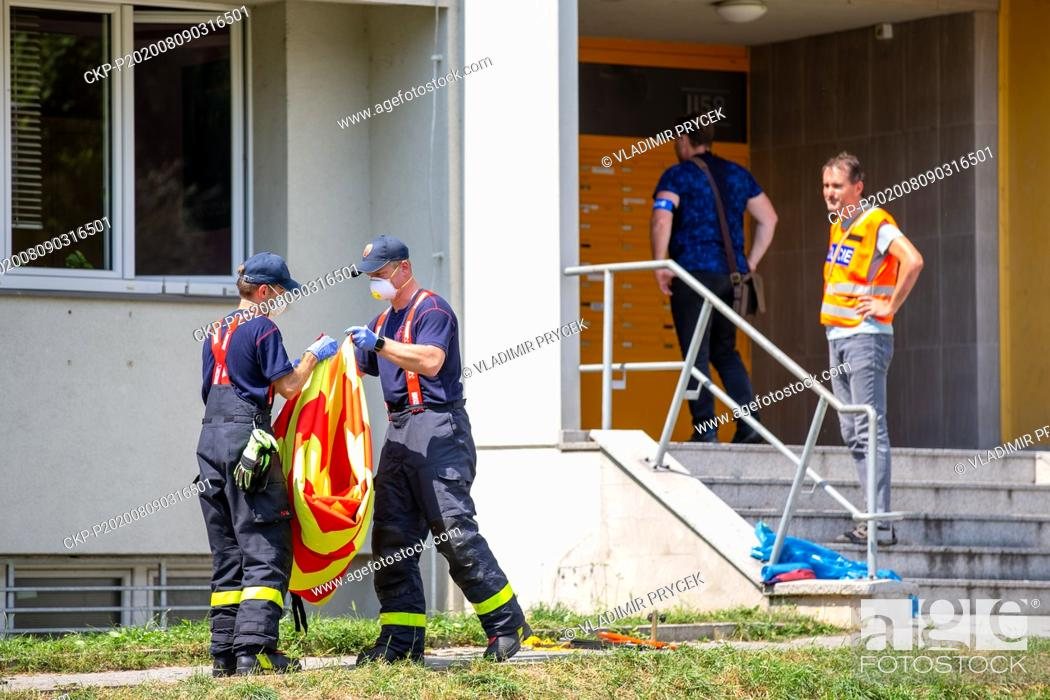 Stock Photo: Firefighters remove a screen one day after arson attack in Bohumin, Czech Republic, on August 9, 2020. Eleven people died in a fire in a pre-fab house in.