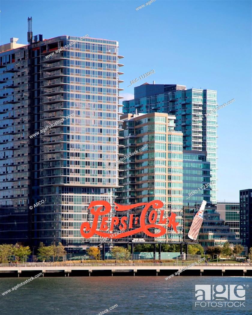 Historic landmark Pepsi Cola sign before recently-constructed luxury ...