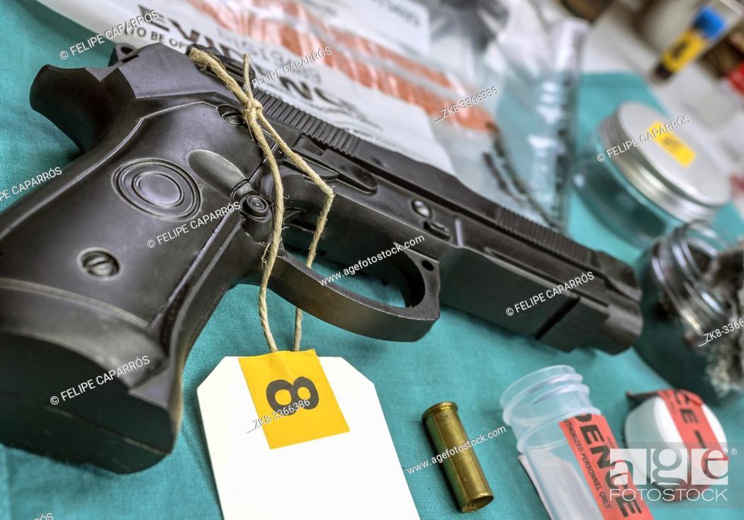 Stock Photo: Criminalistic Laboratory, Bullet shell analysis, conceptual image.