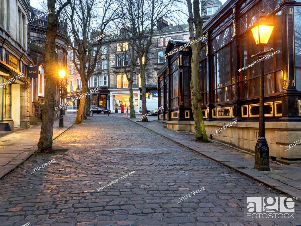 Stock Photo: Crown Place Cobbled Street and Royal Pump Room Museum at Dusk Harrogate North Yorkshire England.