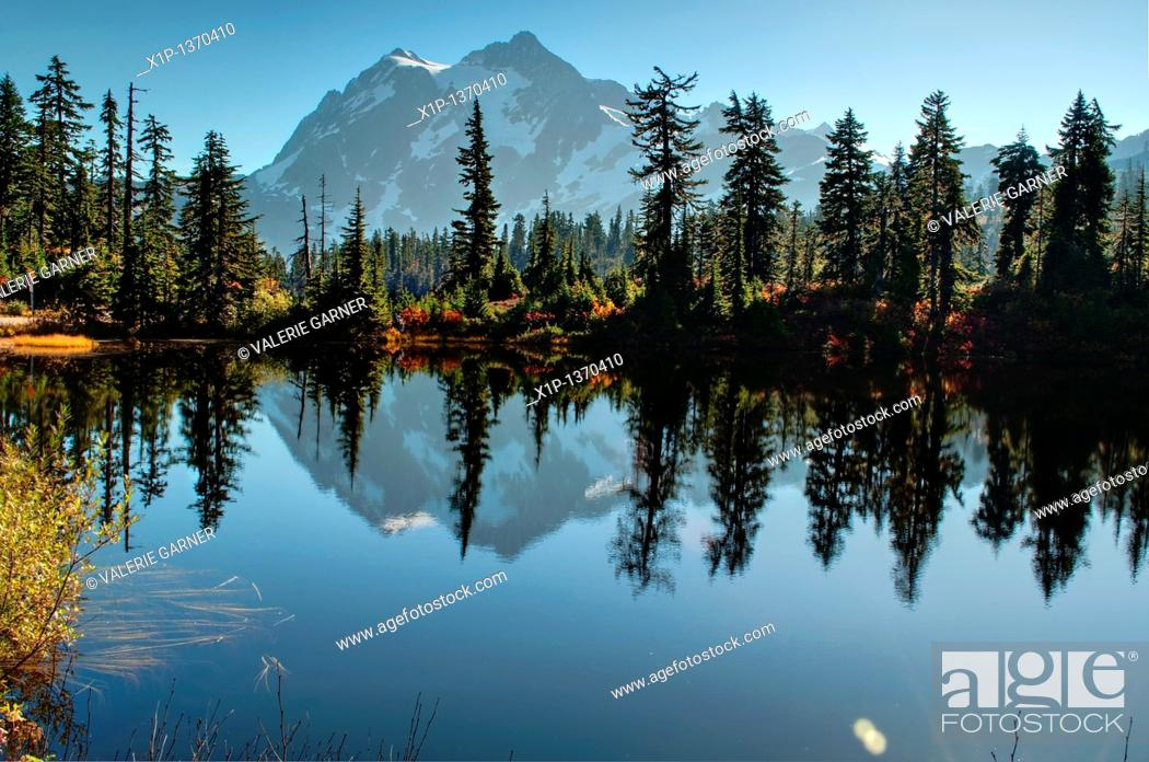 Stock Photo: This landscape photo is of Picture Lake at Heather Meadows on Mt  Baker Washington in autumn  Breath taking mountain is reflected off the water of the lake and.