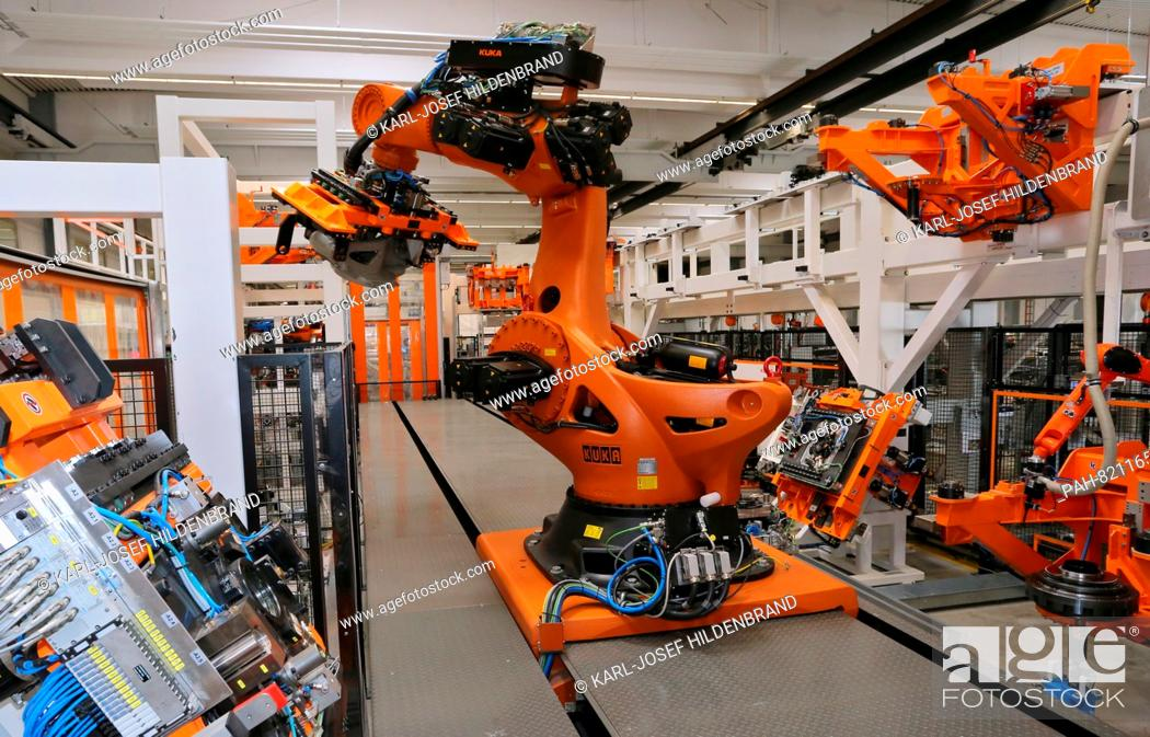 The Kuka robot 'Titan' assembles a robot of the same model