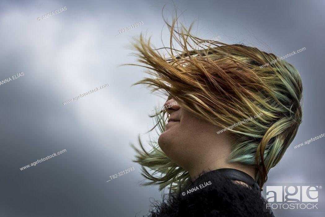 Stock Photo: face teen woman with hair flying over stormy sky, Cadiz, Andalucia, Spain, Europe.