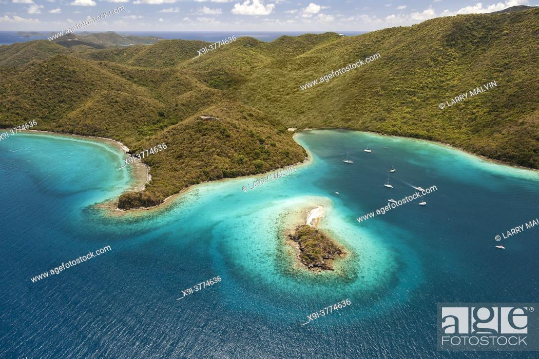 Stock Photo: Aerial view of Waterlemon Cay with boats harboring in the bay on the island of St. John in the United States Virgin Islands.
