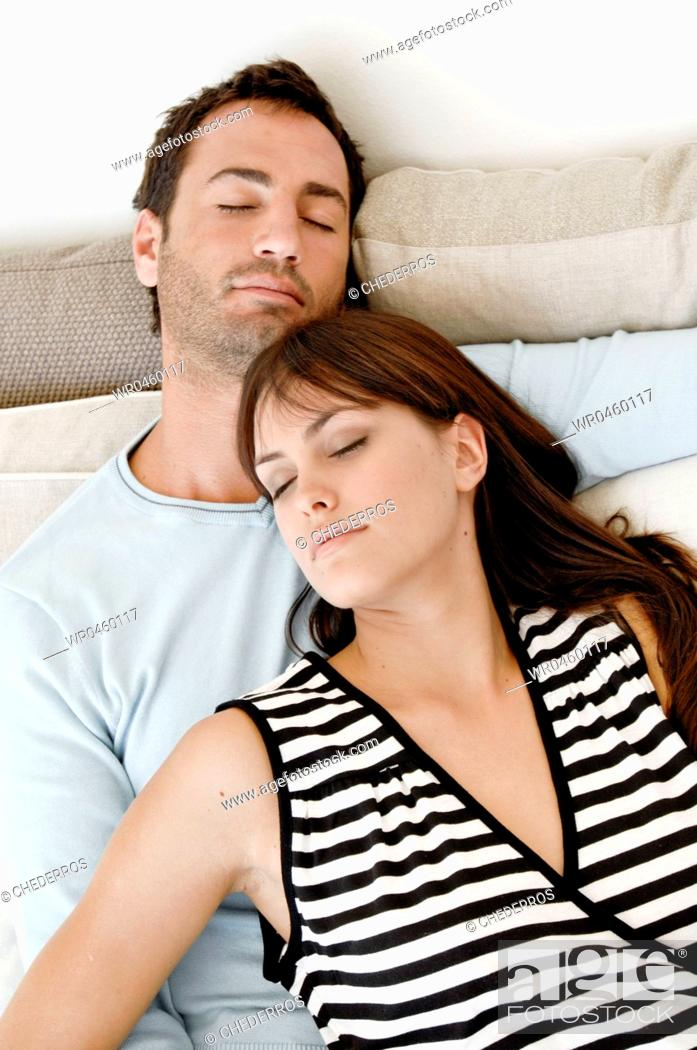 Imagen: High angle view of a young couple sleeping together.