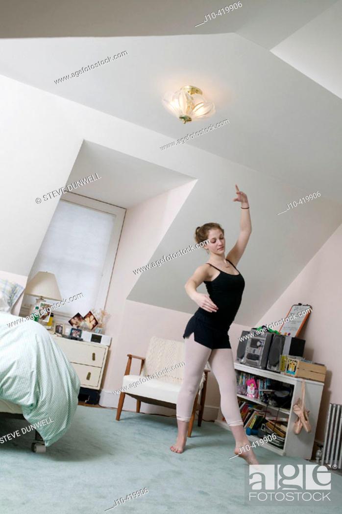 Stock Photo: Teen girl age 17 in bedroom, ballet dancing student.