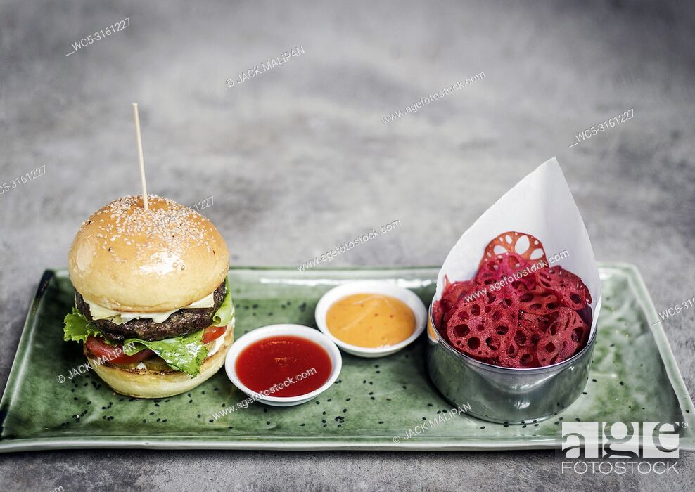 Stock Photo: fusion asian beef burger set with lotus chips and wasabi mayonnaise.