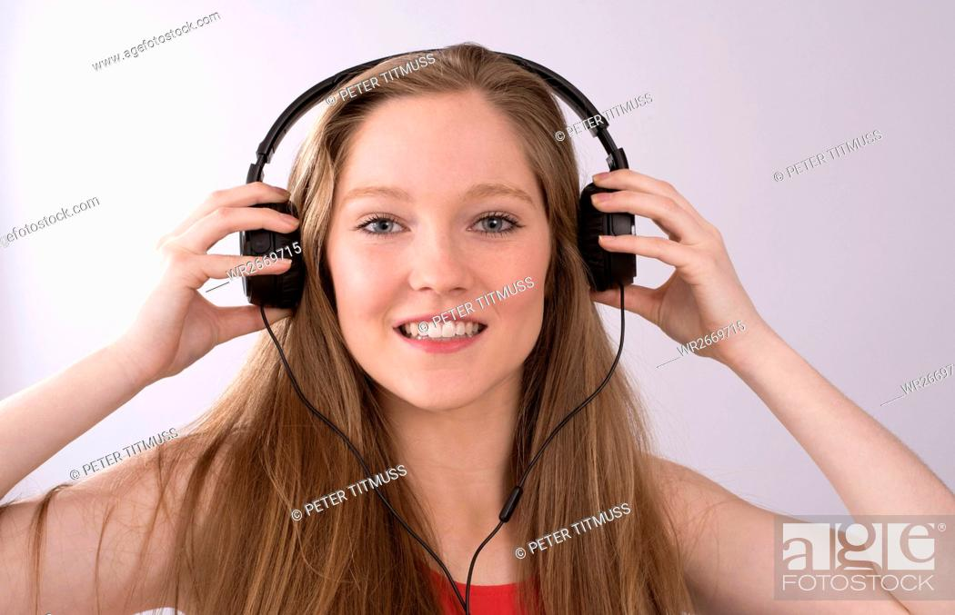 Stock Photo: Teenager with headphones listening to music.