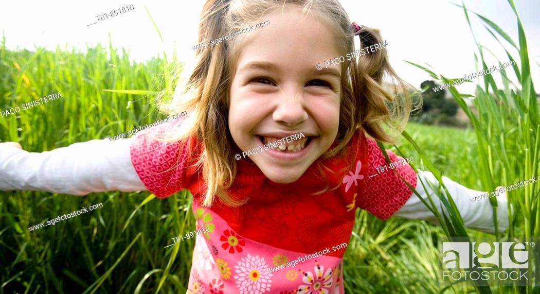 Stock Photo: girl smilingat camera, portrait.
