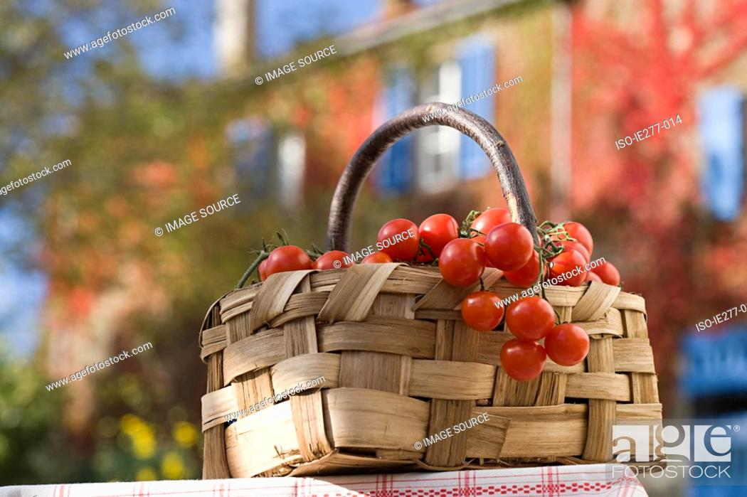 Stock Photo: Basket of cherry tomatoes.