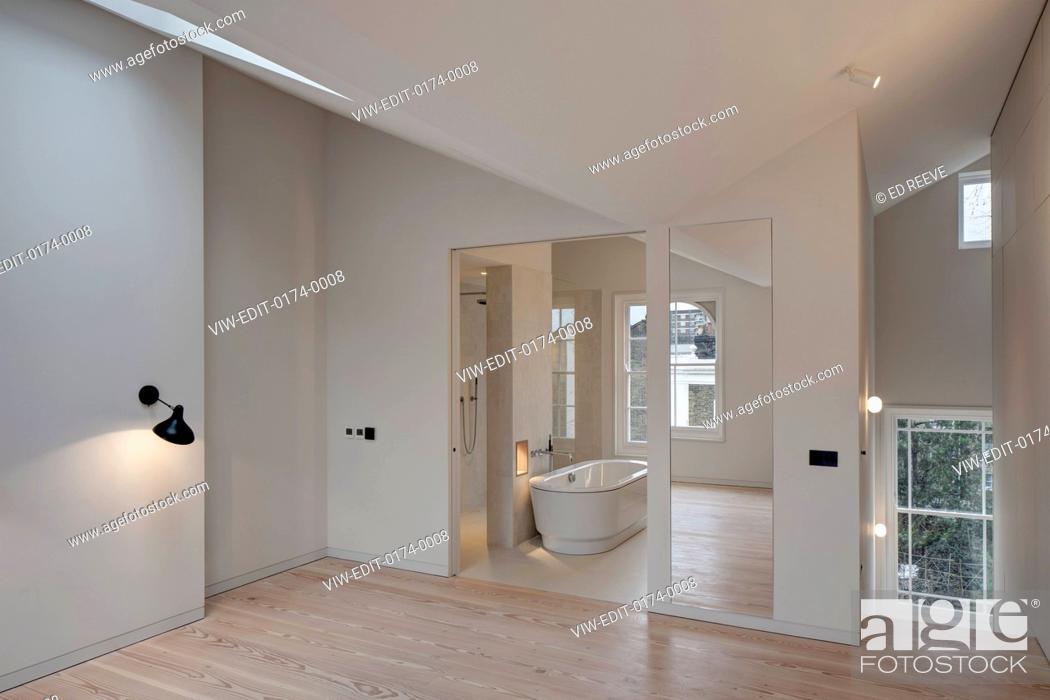 Stock Photo: Bedroom and view of the bathroom. Residence Ockendon Road, London, United Kingdom. Architect: APA London , 2016.