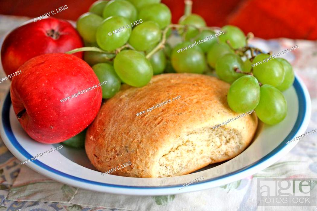 Stock Photo: Bread, apples and grapes on plate  Home-baked broccoli bread with green grapes and red apples on plate  Whole grain wheat bread with broccoli  Very good  bread.