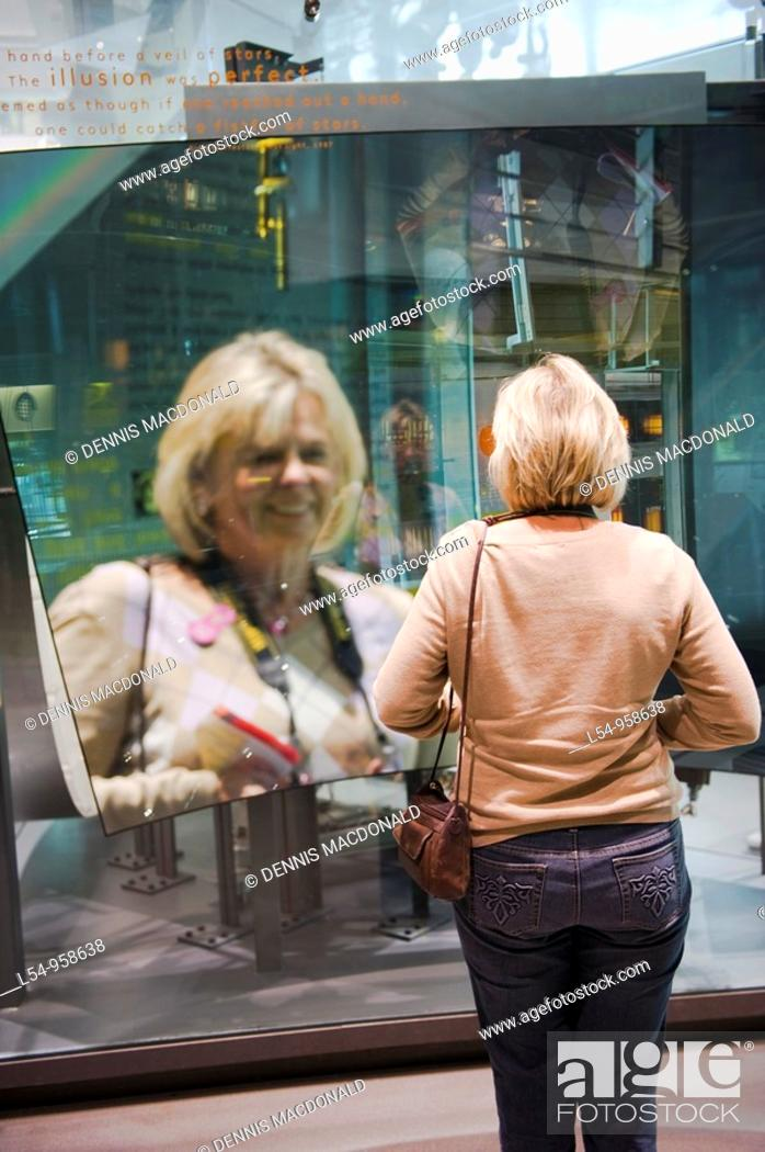 Stock Photo: Visitors Demonstrate Innovations of Glass Display Museum of Glass Corning New York Finger Lakes Region.
