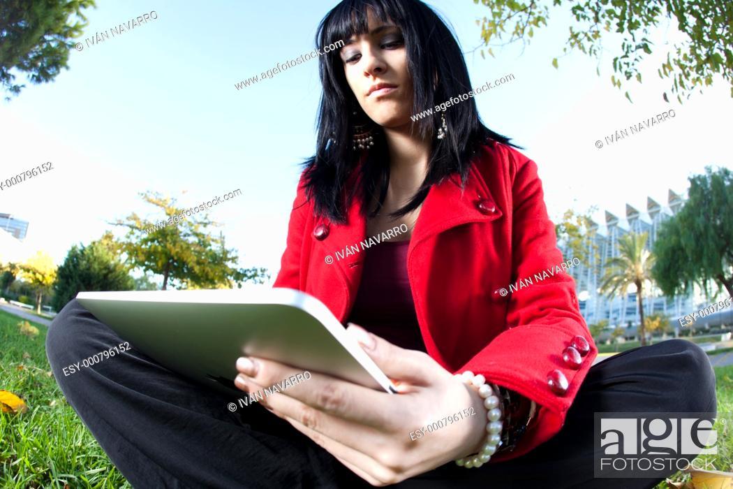 Stock Photo: girl using digital tablet.