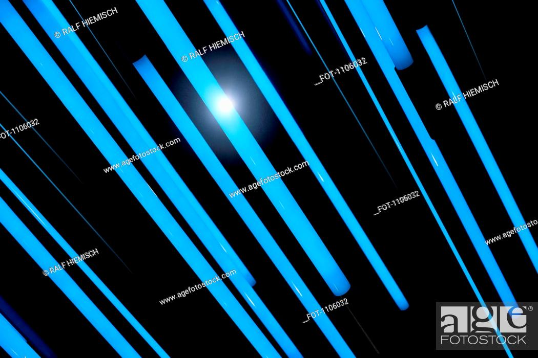 Stock Photo: Neon blue rods of glowing light.