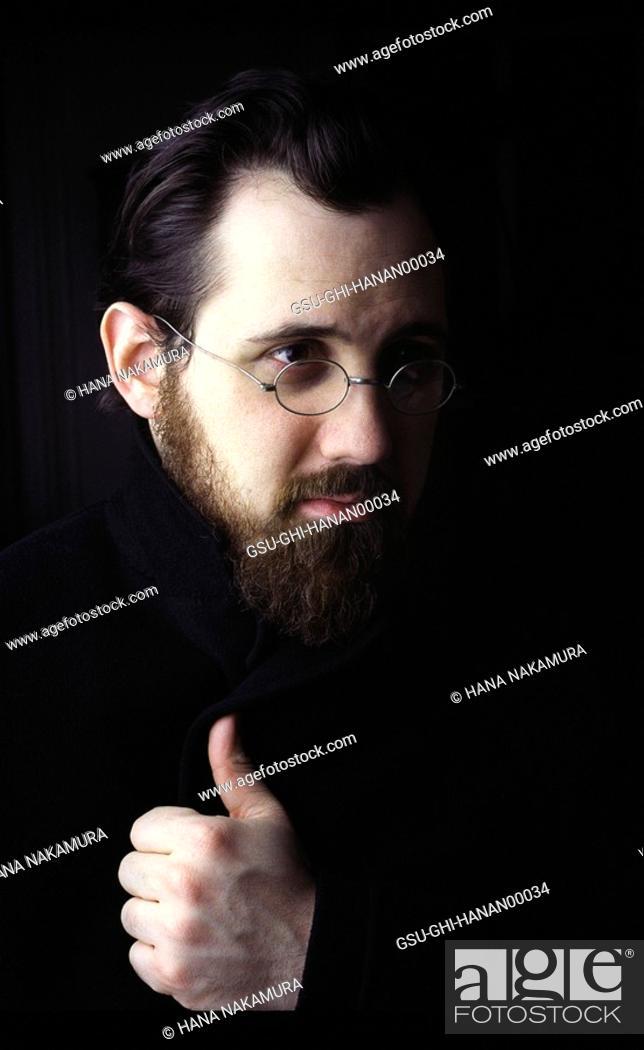 Stock Photo: Bearded Man with Eyeglasses Portrait.