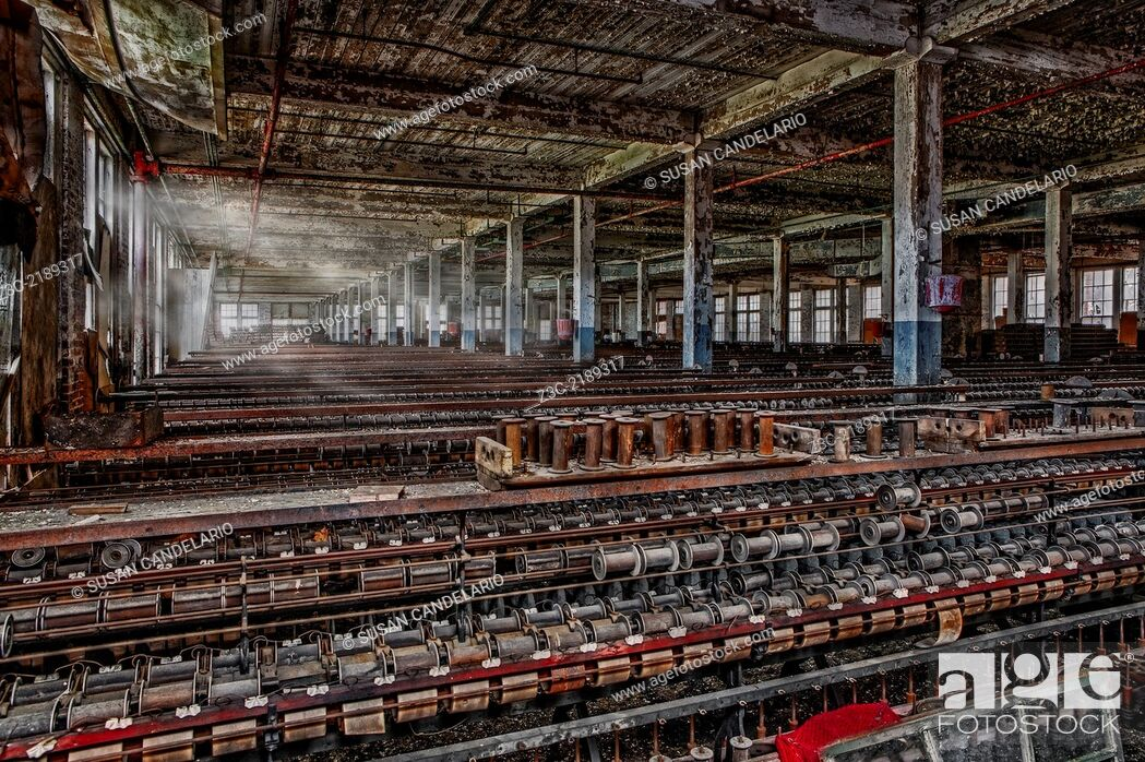 Stock Photo: Rows of industrial machinery and empty spools stopped in time at the last standing Silk Mill in the US located in Lonaconing, Maryland.