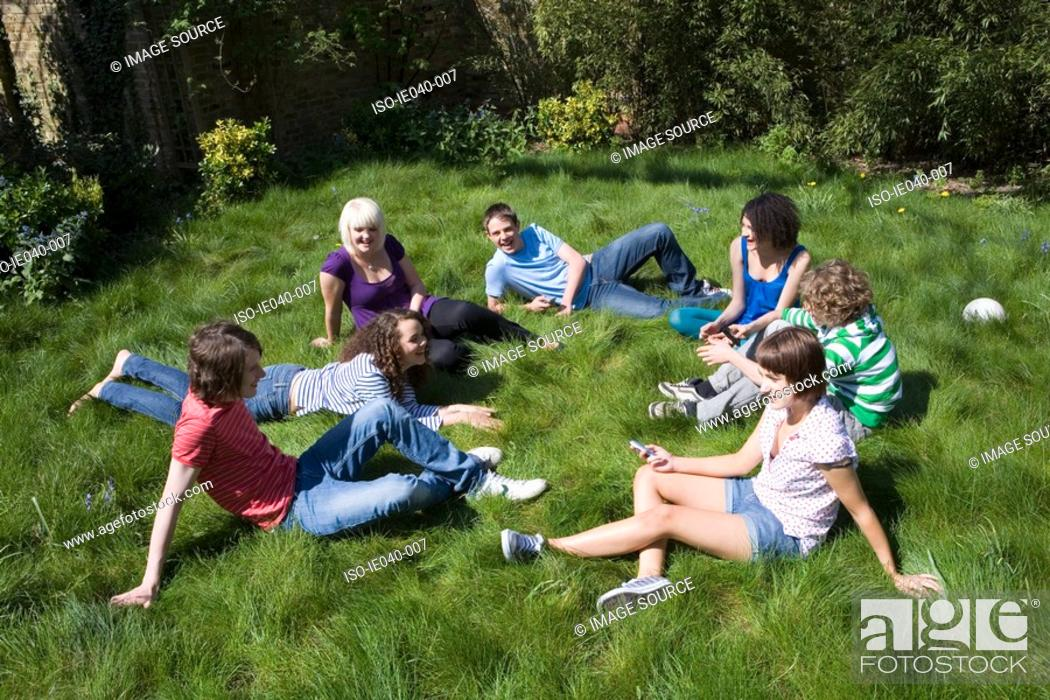 Stock Photo: Friends sat in a circle.