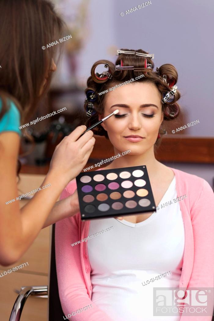 Stock Photo: Prepare at the hairdresser and makeup artist before party. Debica, Poland.