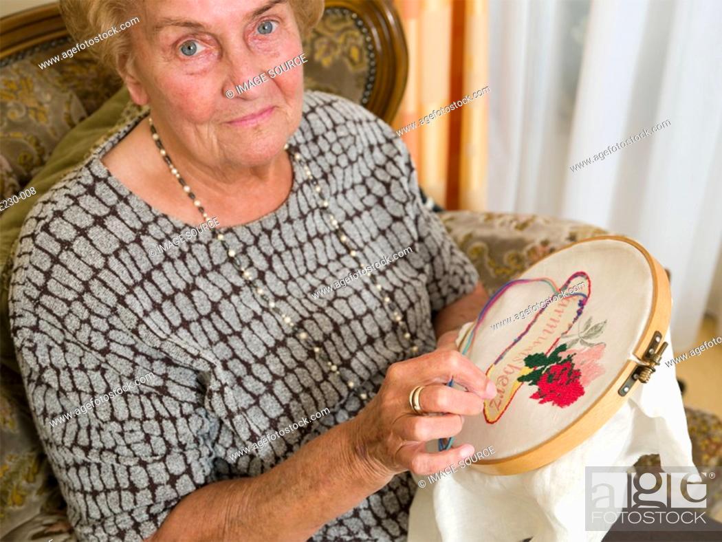 Stock Photo: Senior woman doing crochet.