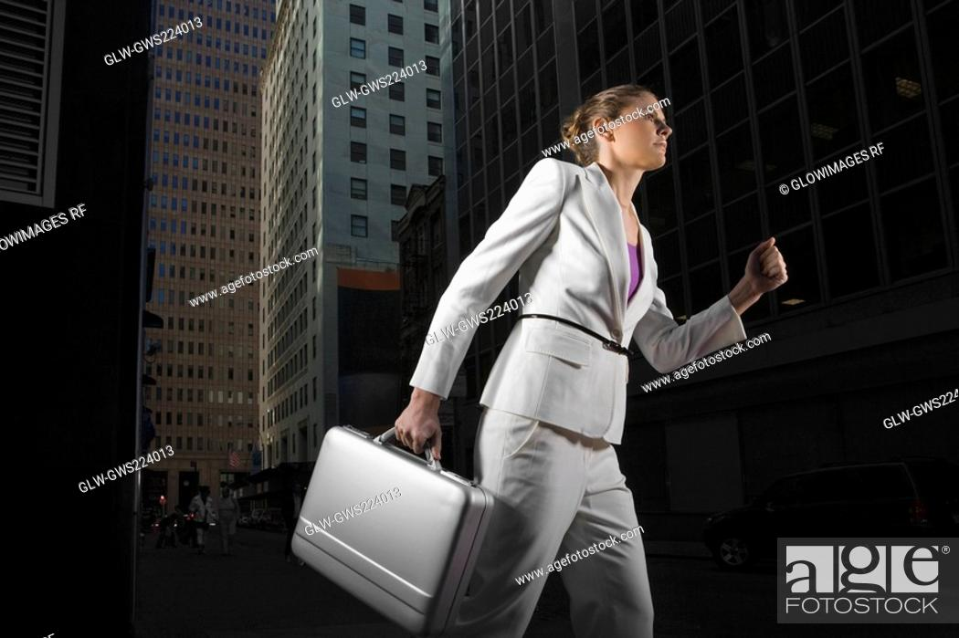 Stock Photo: Low angle view of a businesswoman carrying a briefcase.