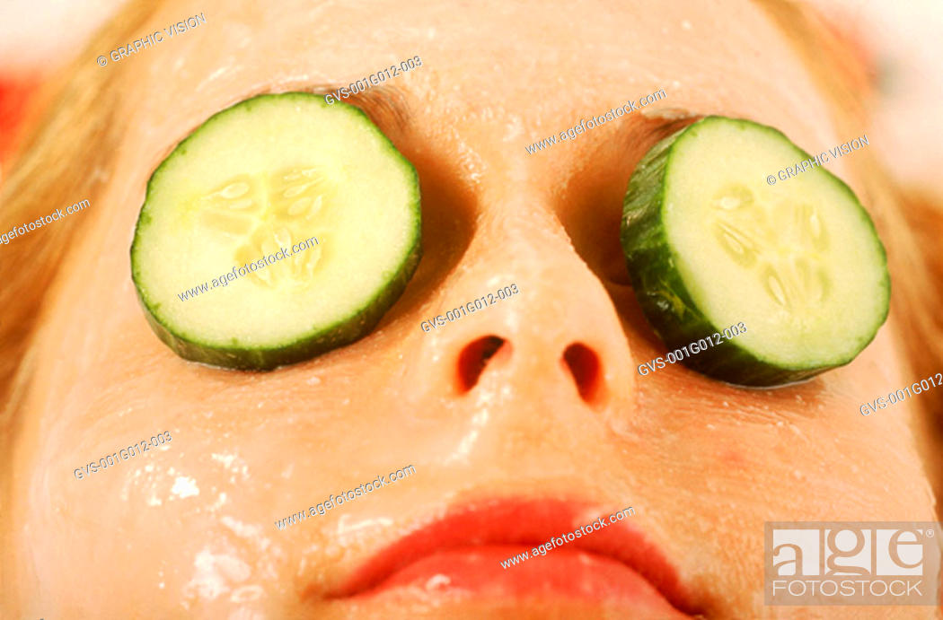 Stock Photo: Close-up of a woman's eyes covered with cucumber slices.
