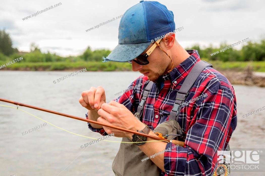 Photo de stock: Man preparing bait in river, Clark Fork, Montana and Idaho, US.