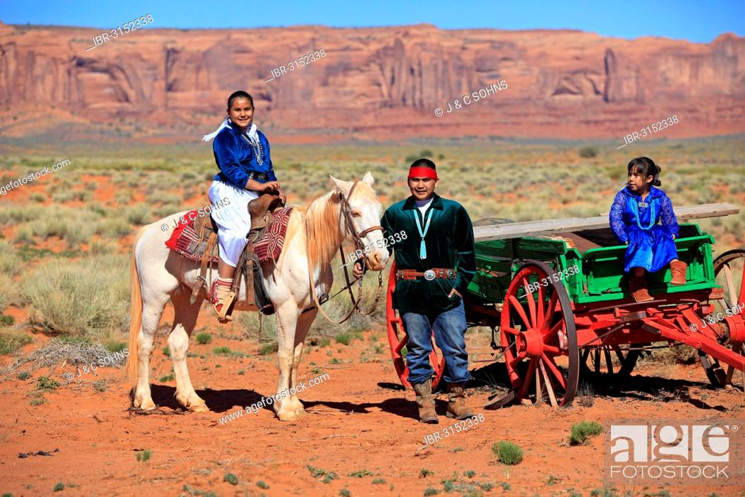 Stock Photo: Navajo Indian family with a horse and carriage, Monument Valley, Utah, United States.