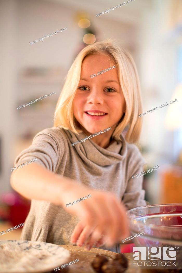 Stock Photo: Girl baking for Christmas.