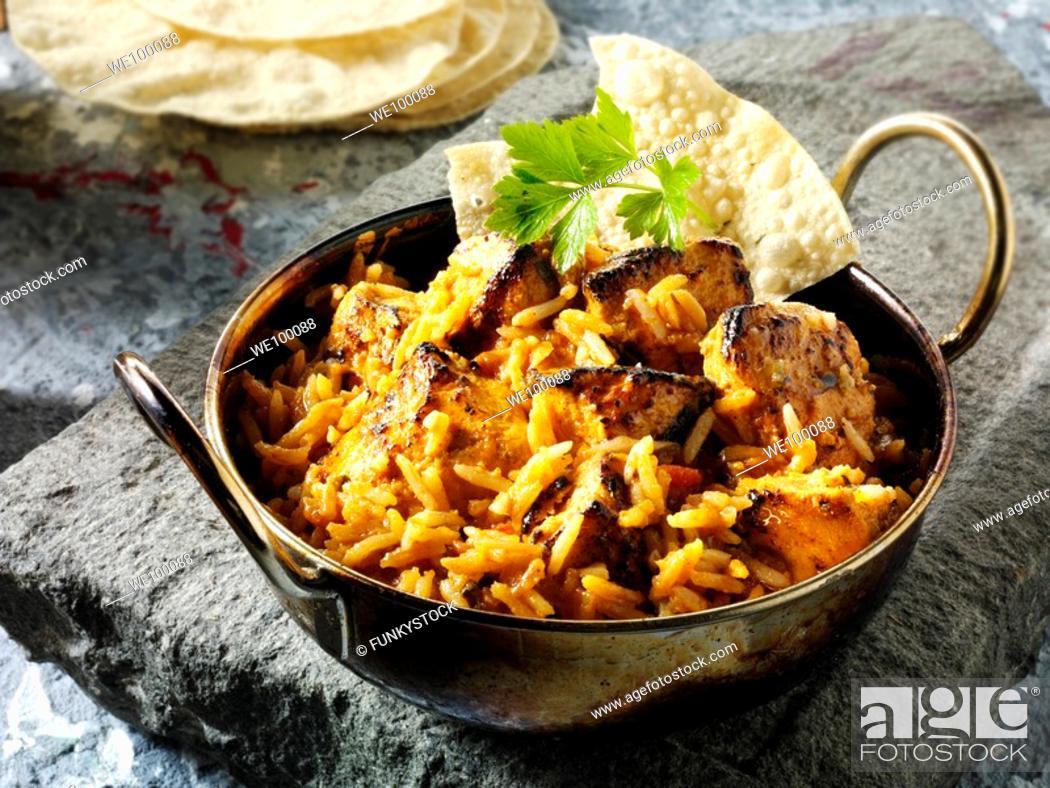 Stock Photo: Chicken Tikka Byriani Indian food recipe.