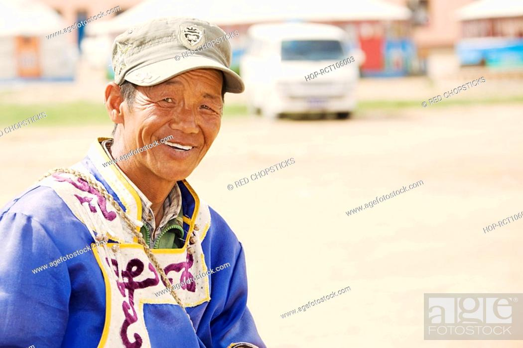 Stock Photo: Close-up of a mature man smiling, Inner Mongolia, China.