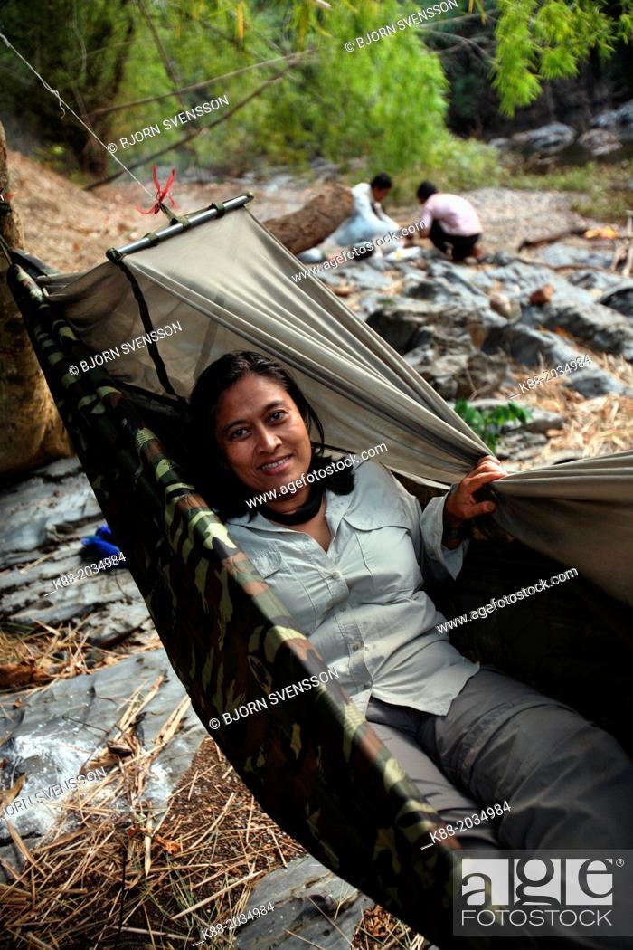Stock Photo: Tourists sleeping in hammocks along the O Chbar river. Dey Ei Trek, Mondulkiri, Cambodia.
