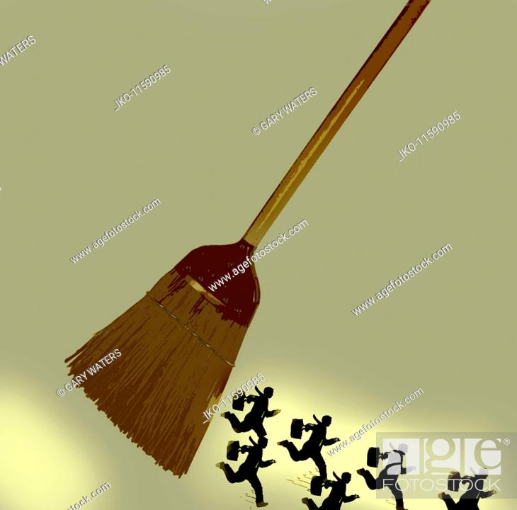 Businessmen running away from sweeping broom, Stock Photo