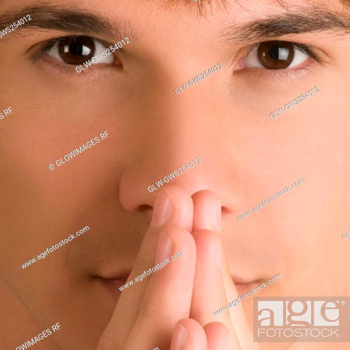 Stock Photo: Portrait of a young man thinking.
