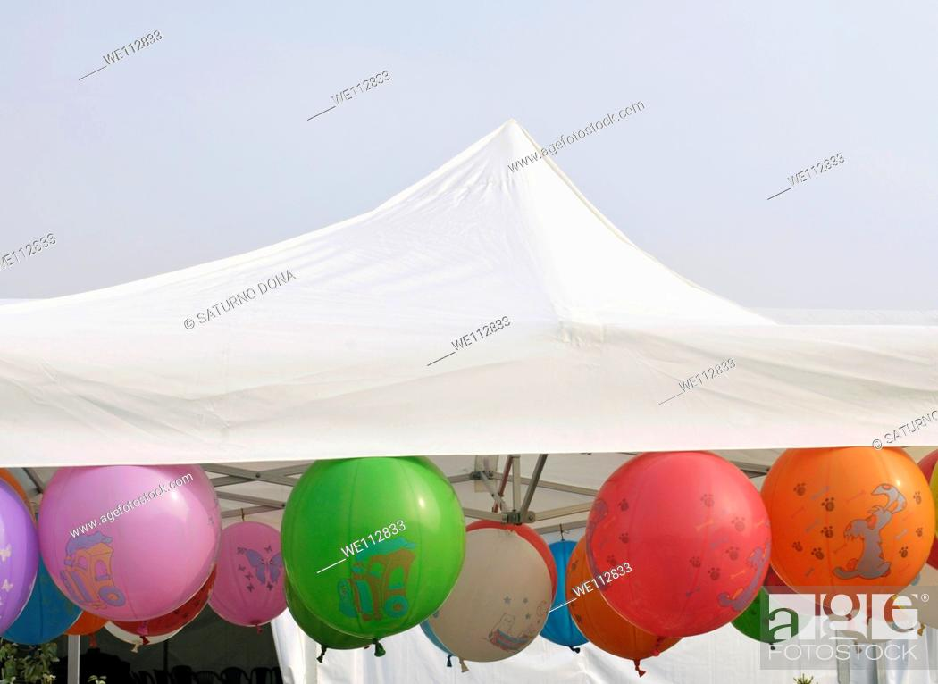 Stock Photo: Inflated balloons under tent.