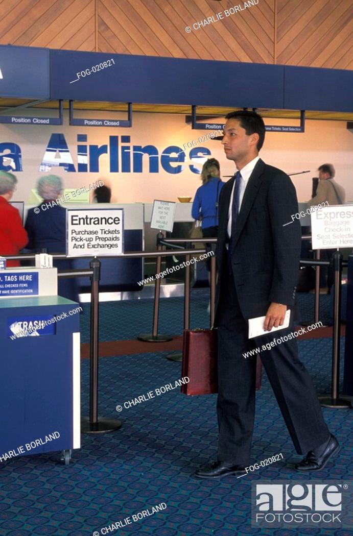 Stock Photo: Man Walking Through Airport.