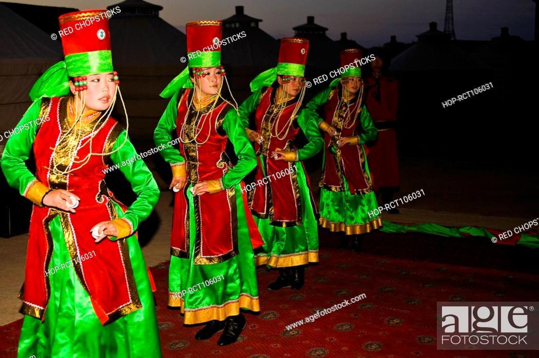 Stock Photo: Four young women dancing, Inner Mongolia, China.