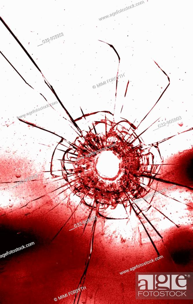 Stock Photo: Bullet hole in glass.